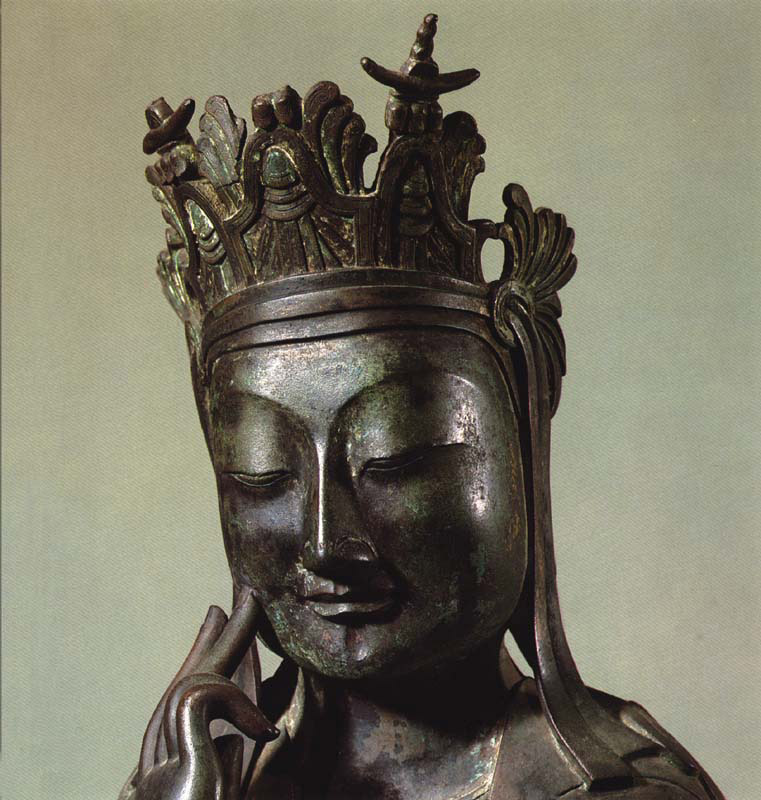 The Facial Expression of Meditating Half-Seated Statue