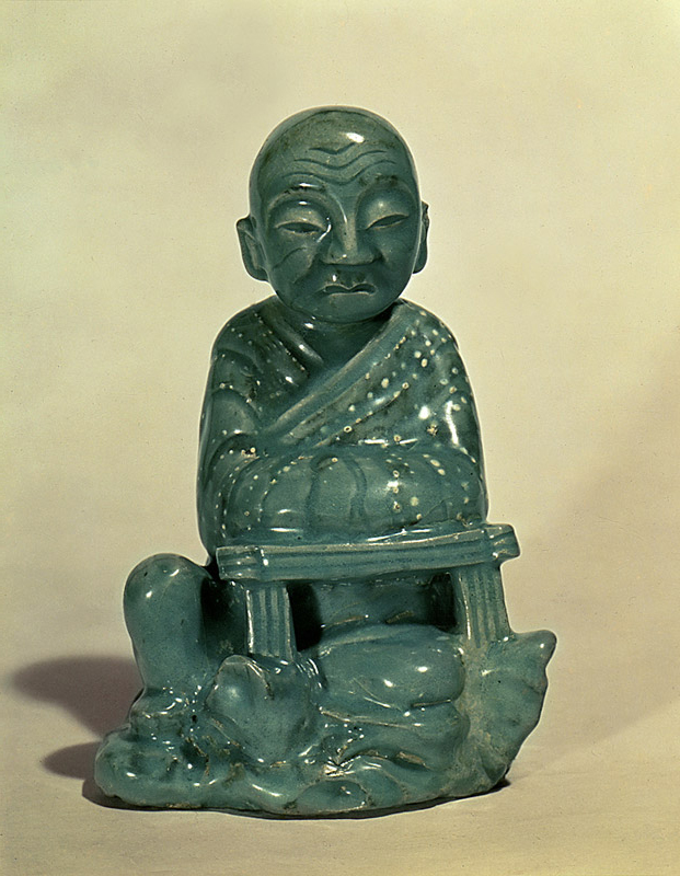 Seated Celadon Arhat Statue with Dot Design in Underglaze Iron